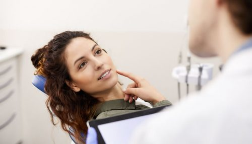 young-woman-consulting-dentist-NY5GS62-forster-court-dental-galway-m